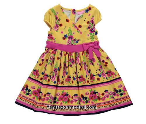 sari-cicek-desenli-dusuk-kollu-kiz-cocuk-elbiseleri